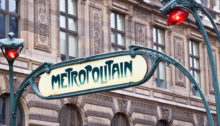 Paris Metropolitain sign agains the wall